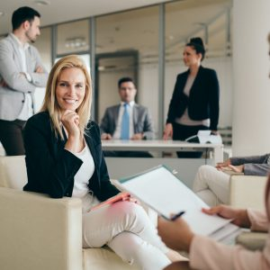 Picture of attractive smiling salesworkers on meeting in office